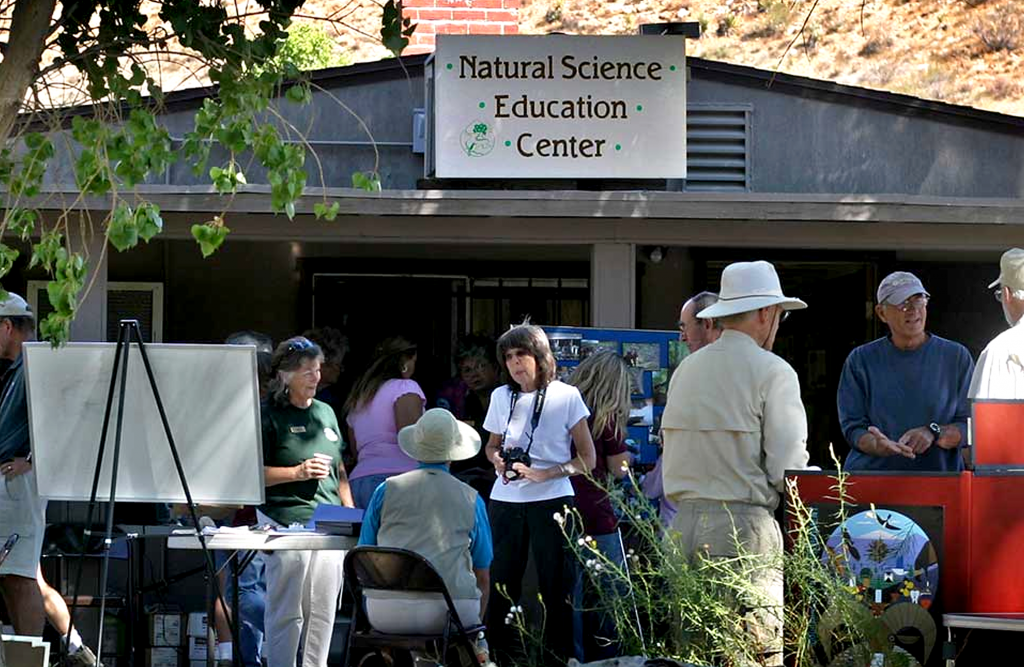People standing in front of the Natural Science Education Center at Big Morongo Canyon Preserve.