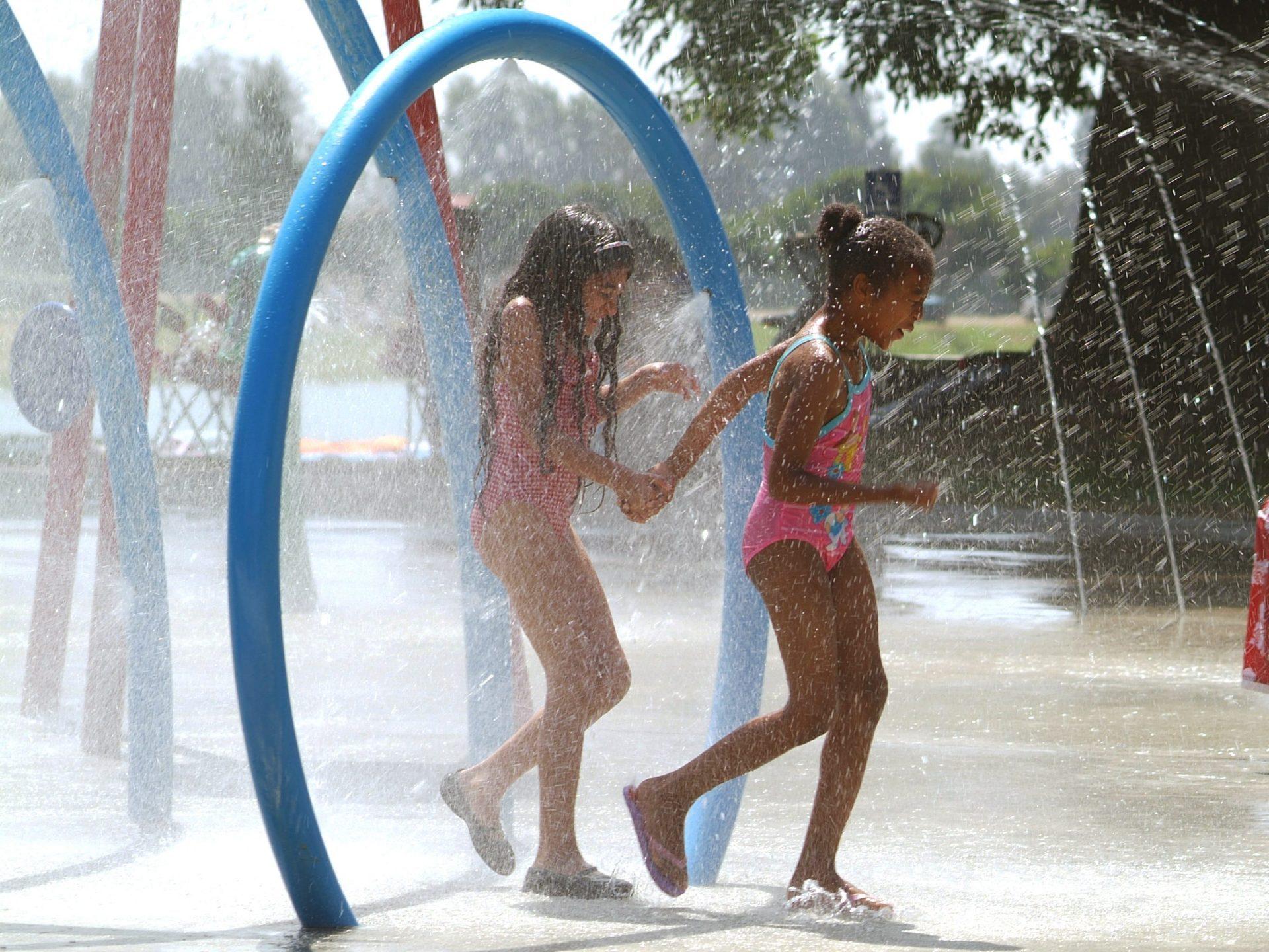 girls at splash pad