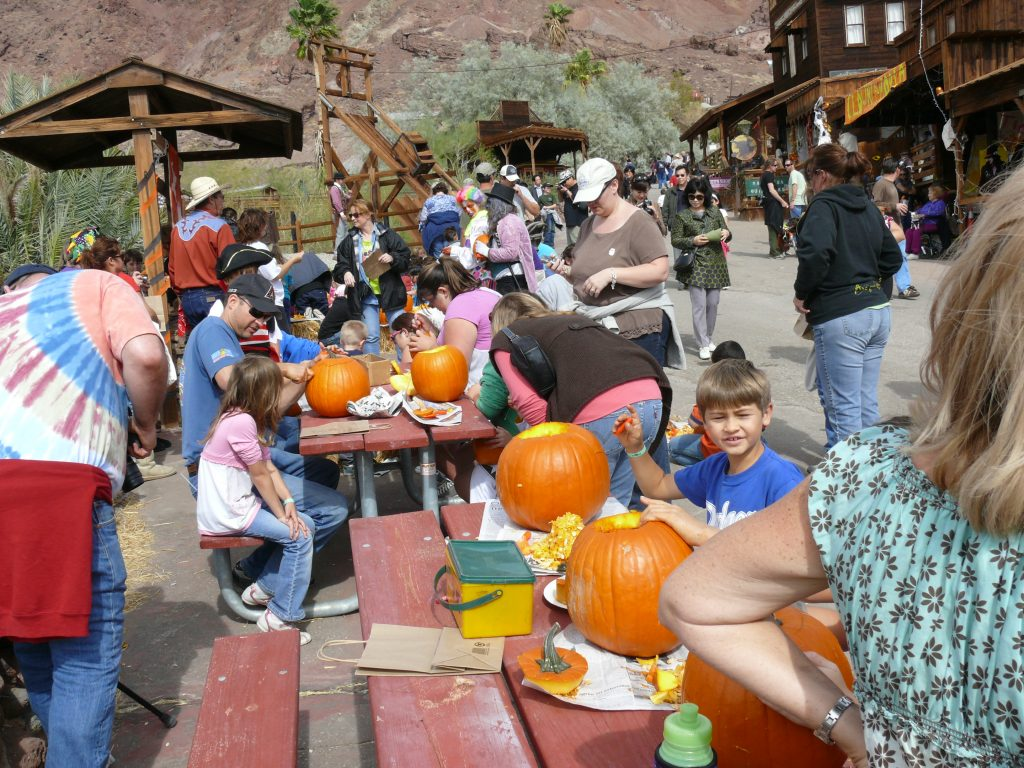 Calico Ghost Town visitors carving pumpkins