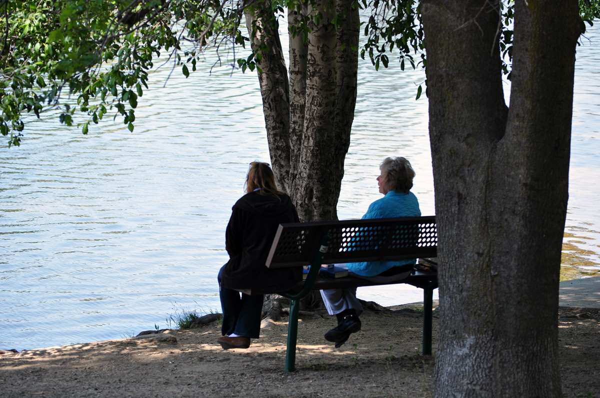 ladies on a bench by the lake