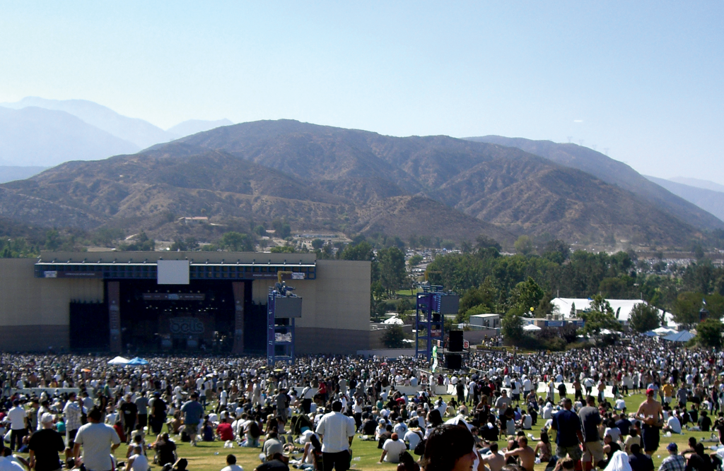 A large crowd gathers in front of a stage at Glen Helen.