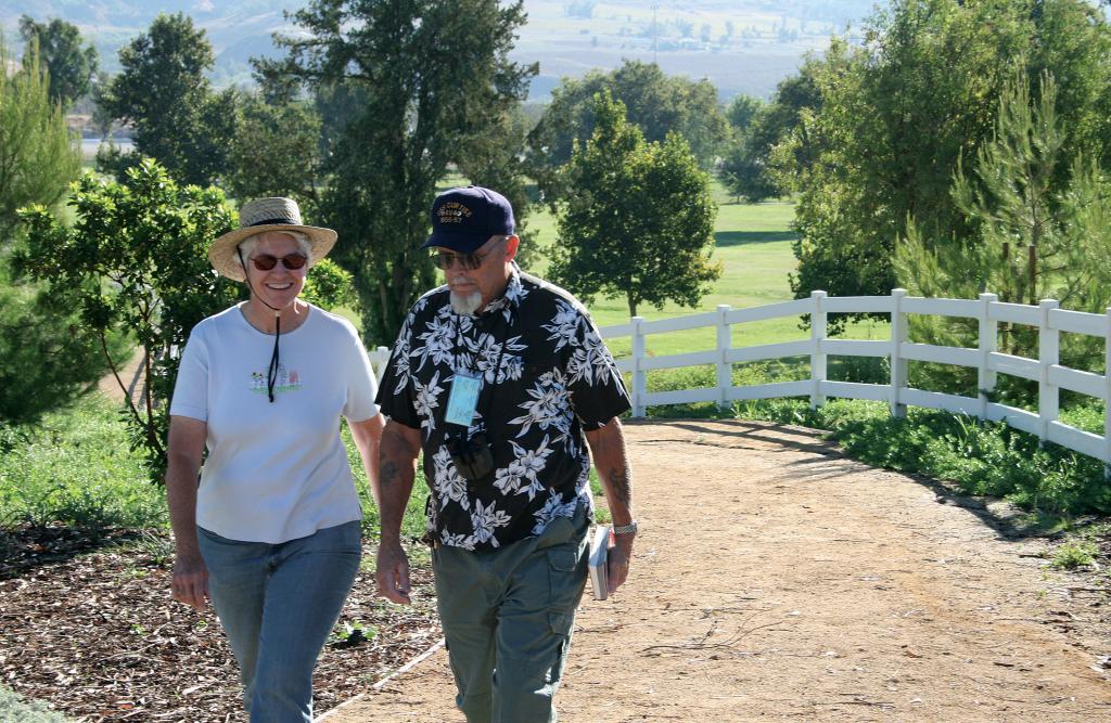 Elderly man and woman walking Glen Helen trail.