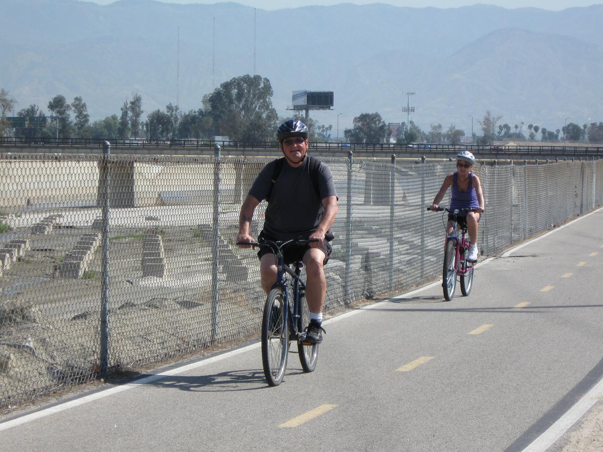 Couple on paved bike trail