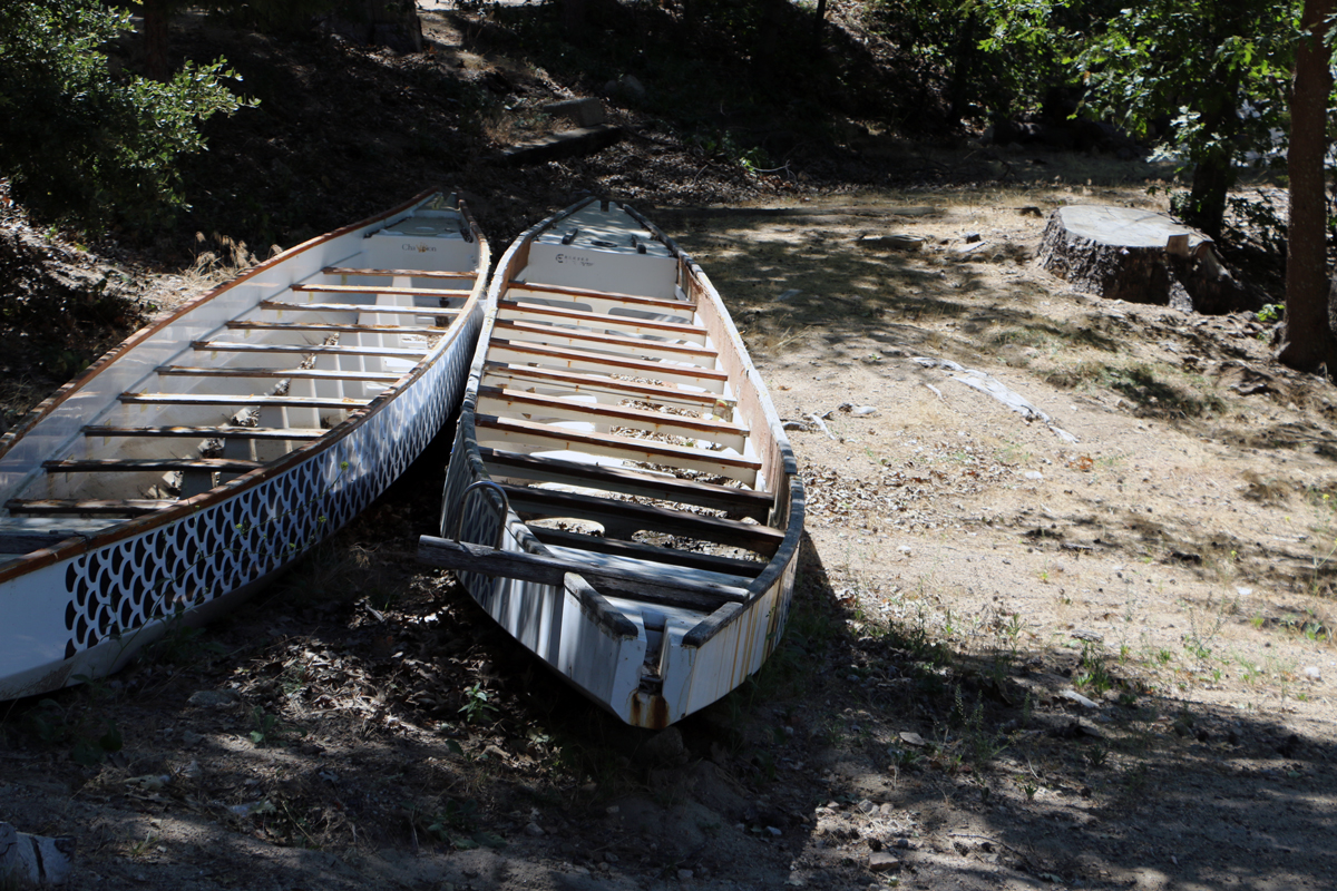 2 boats on a shoreline