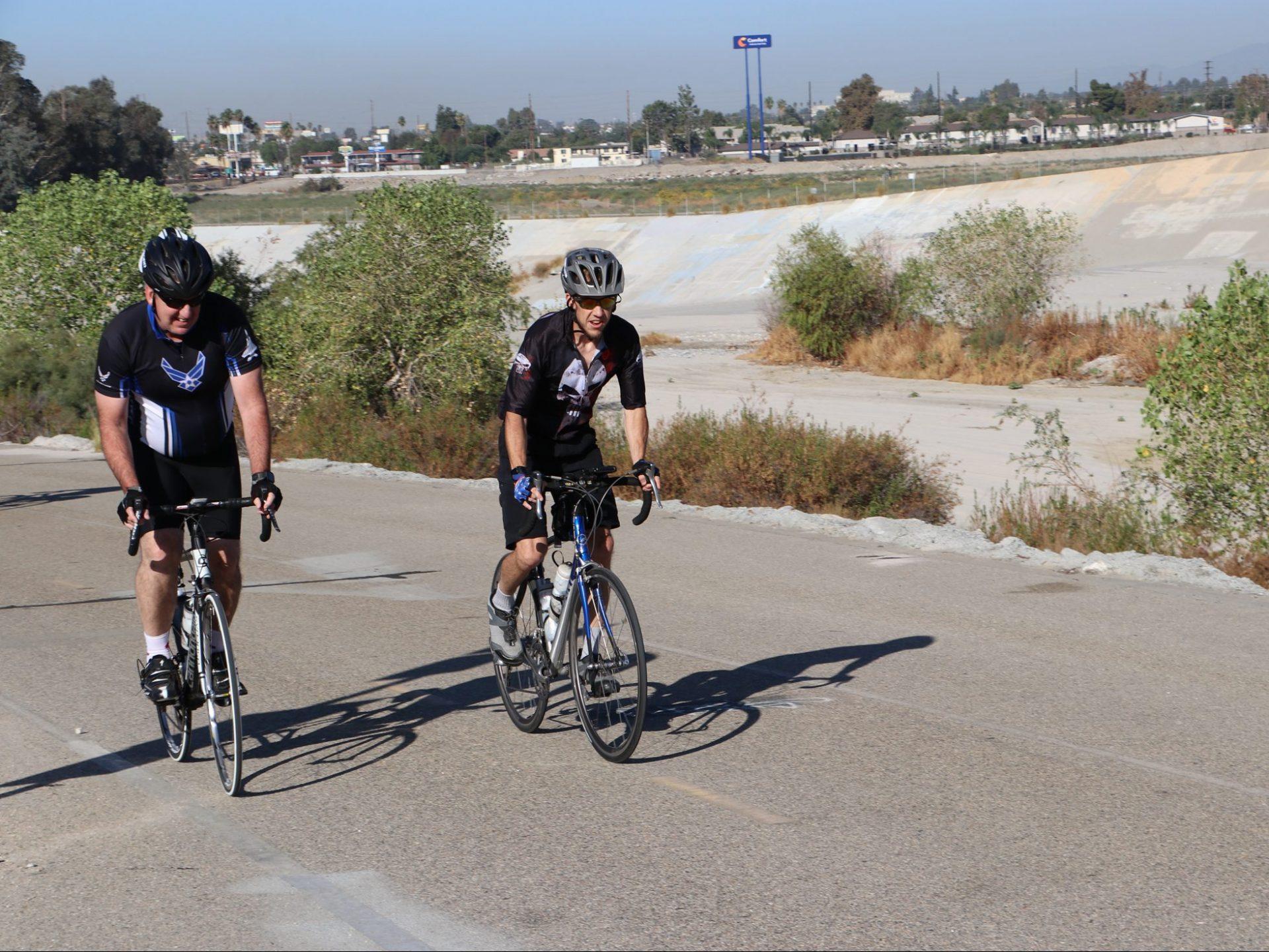 2 men on paved Bike trail 1