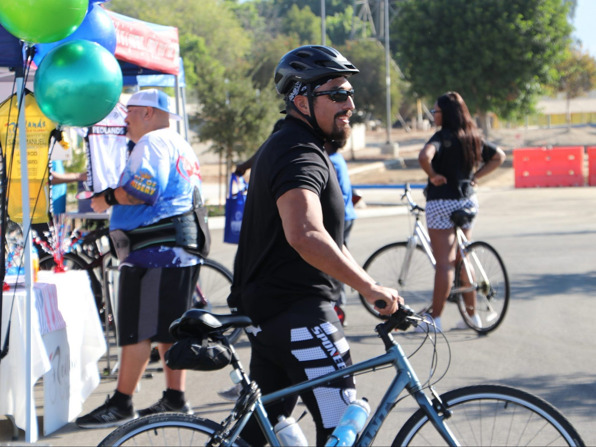 Man holding bike at event