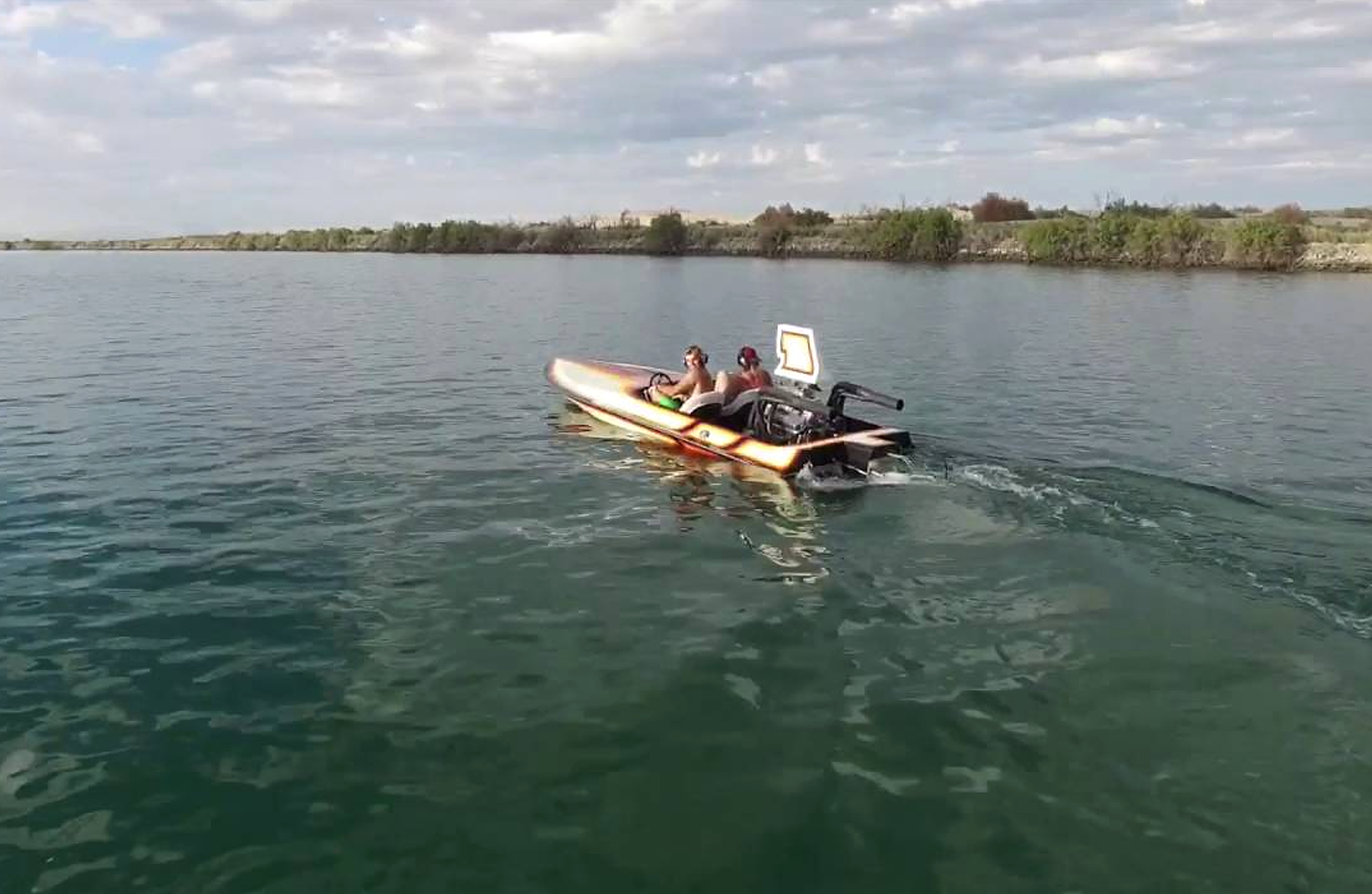 People on small power boat- blurry image