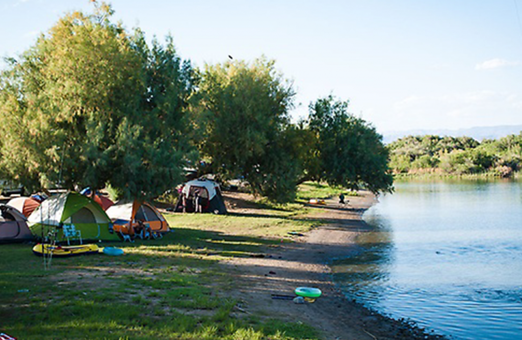 tents lined up on the shore of the peninsula of Moabi.