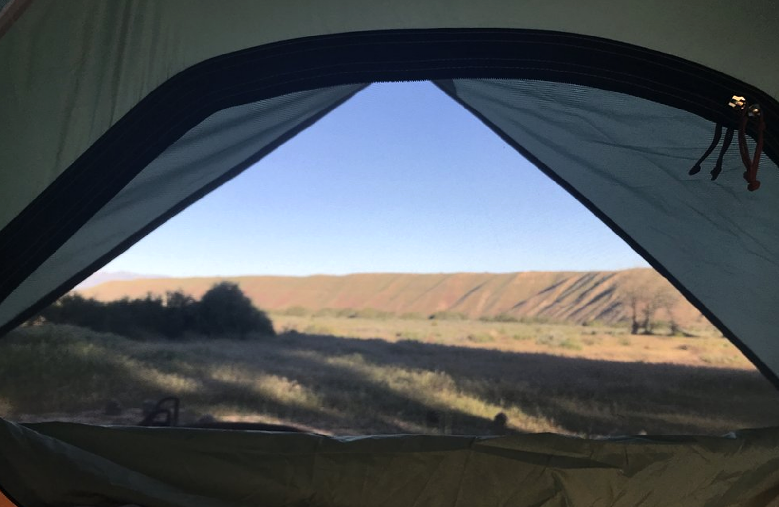 A view from inside looking out in a open tent at Mojave River Forks.