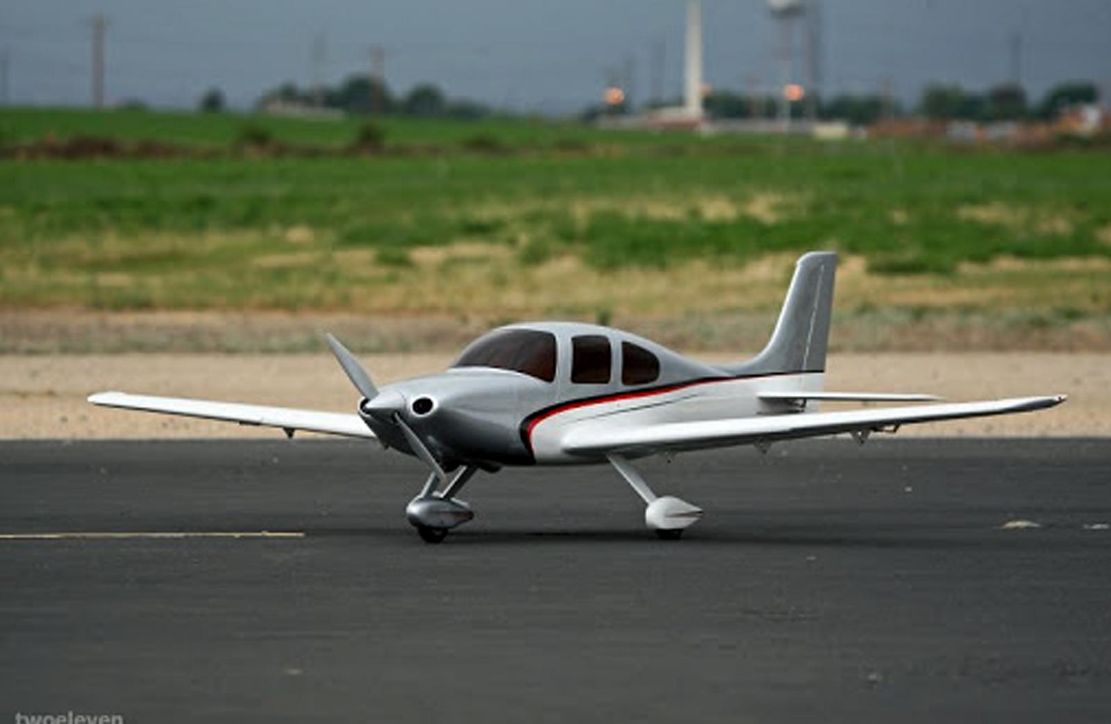 A model airplane on the runaway at Prado park airfield.