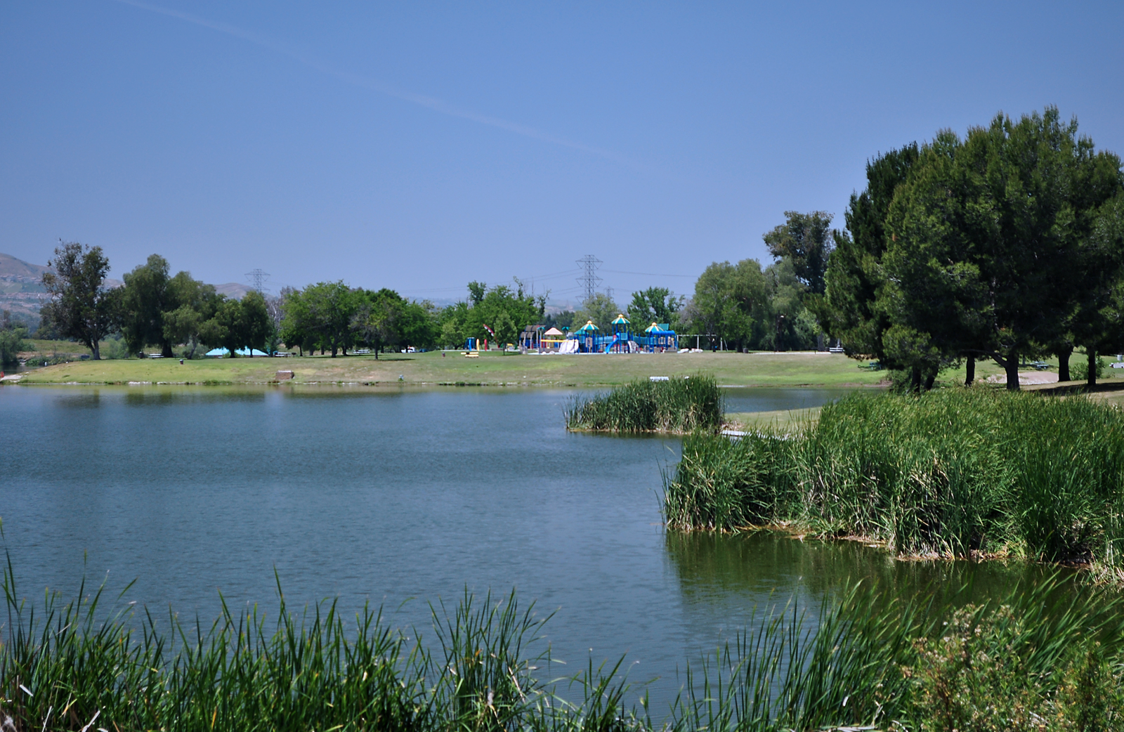Prado lake view with playground in the background.