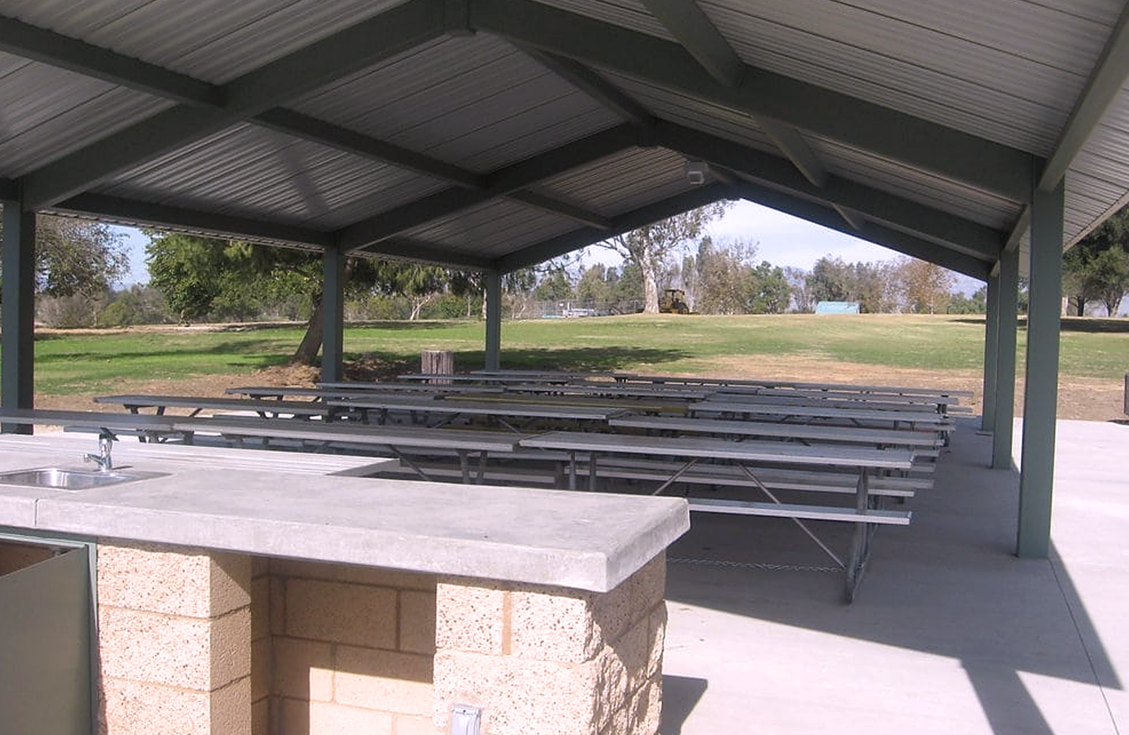 A closer view of a large picnic shelter at Prado park.