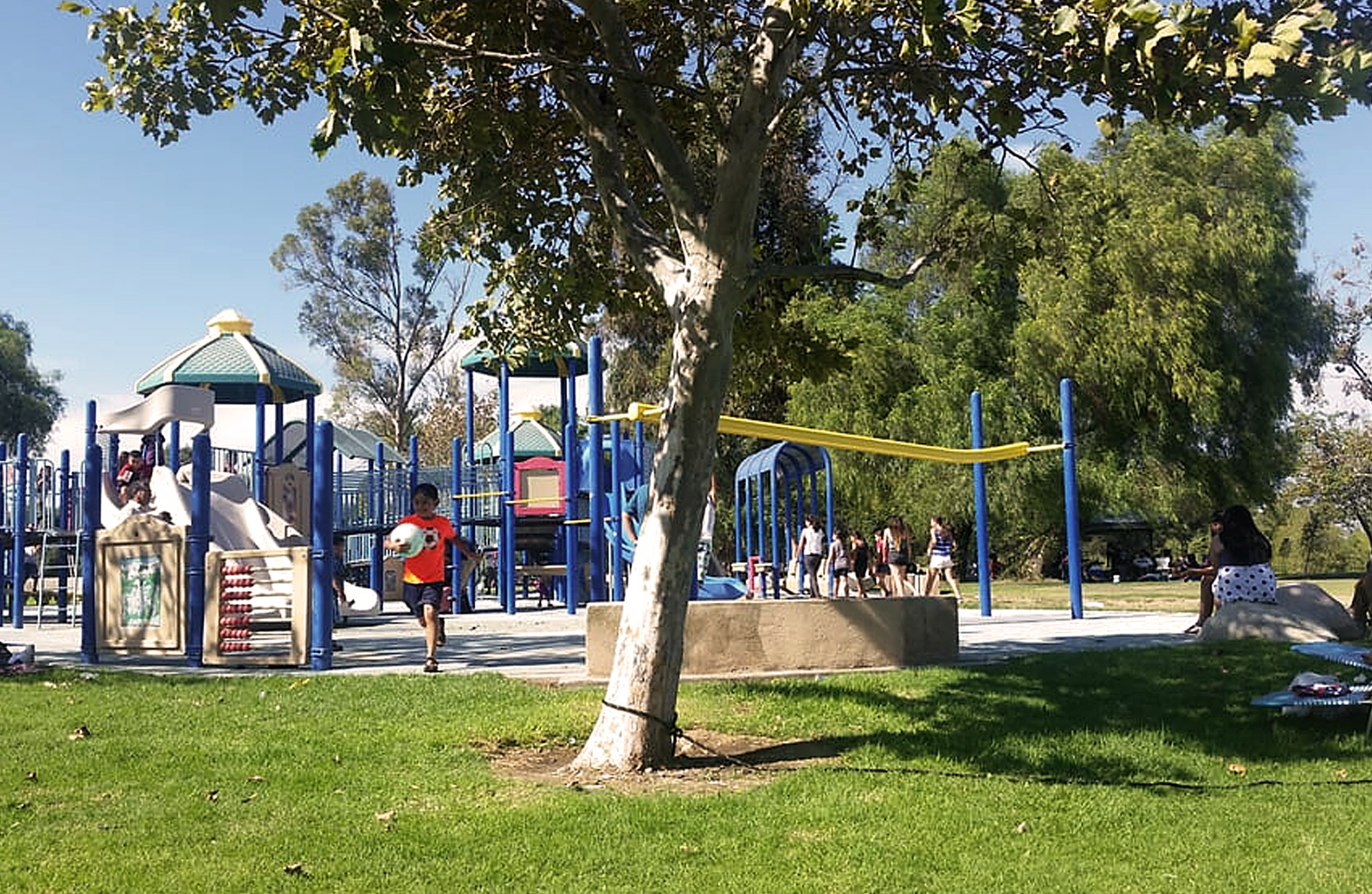 Children playing at Prado park playground.