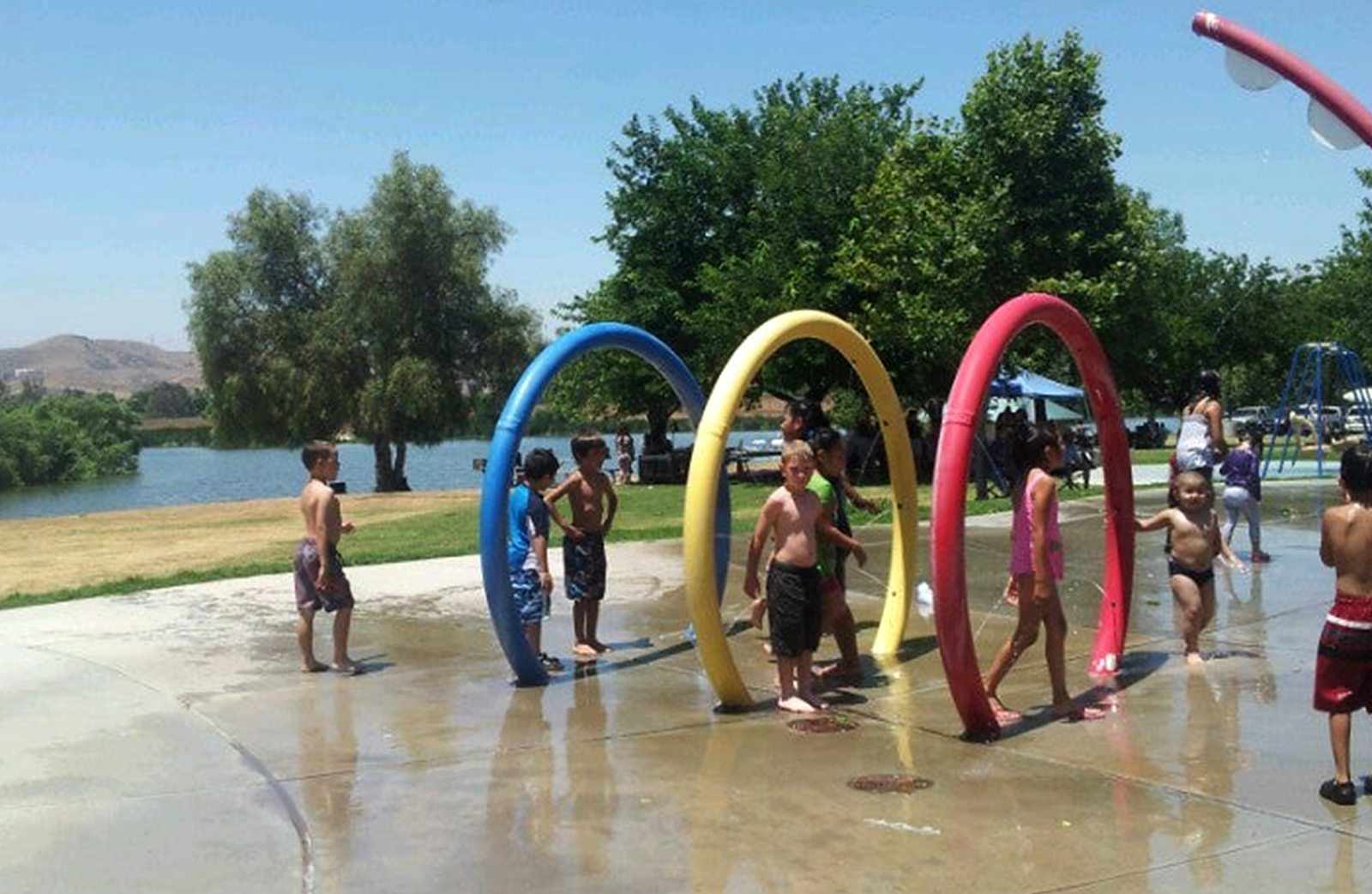 Childen run and play at Prado splash pad.