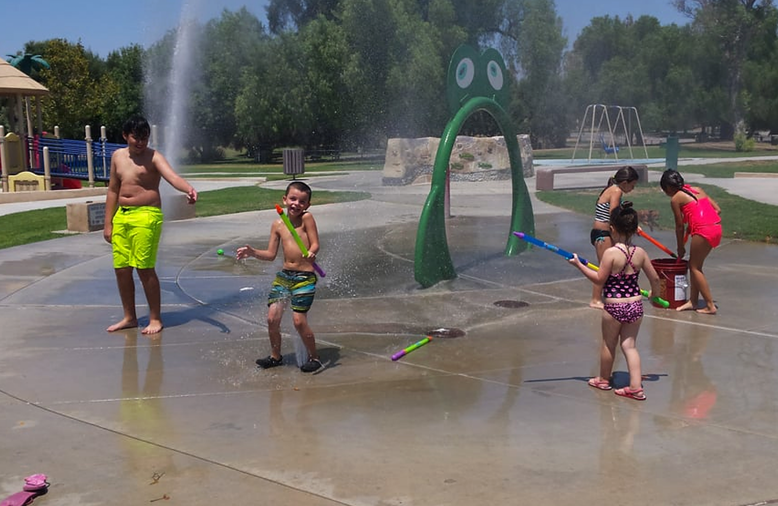 Children play at Prado splash pad.