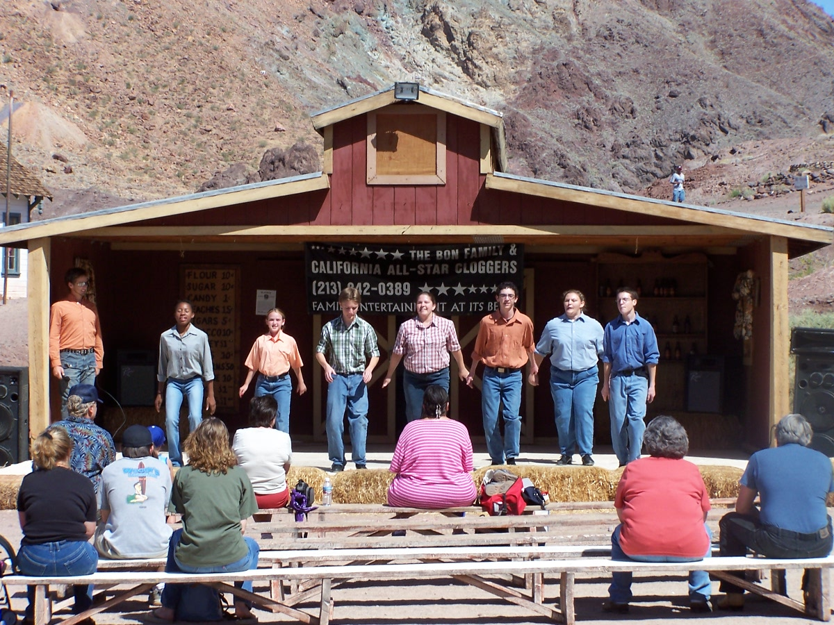Seven people standing on outdoor stage at Calico Ghost Town