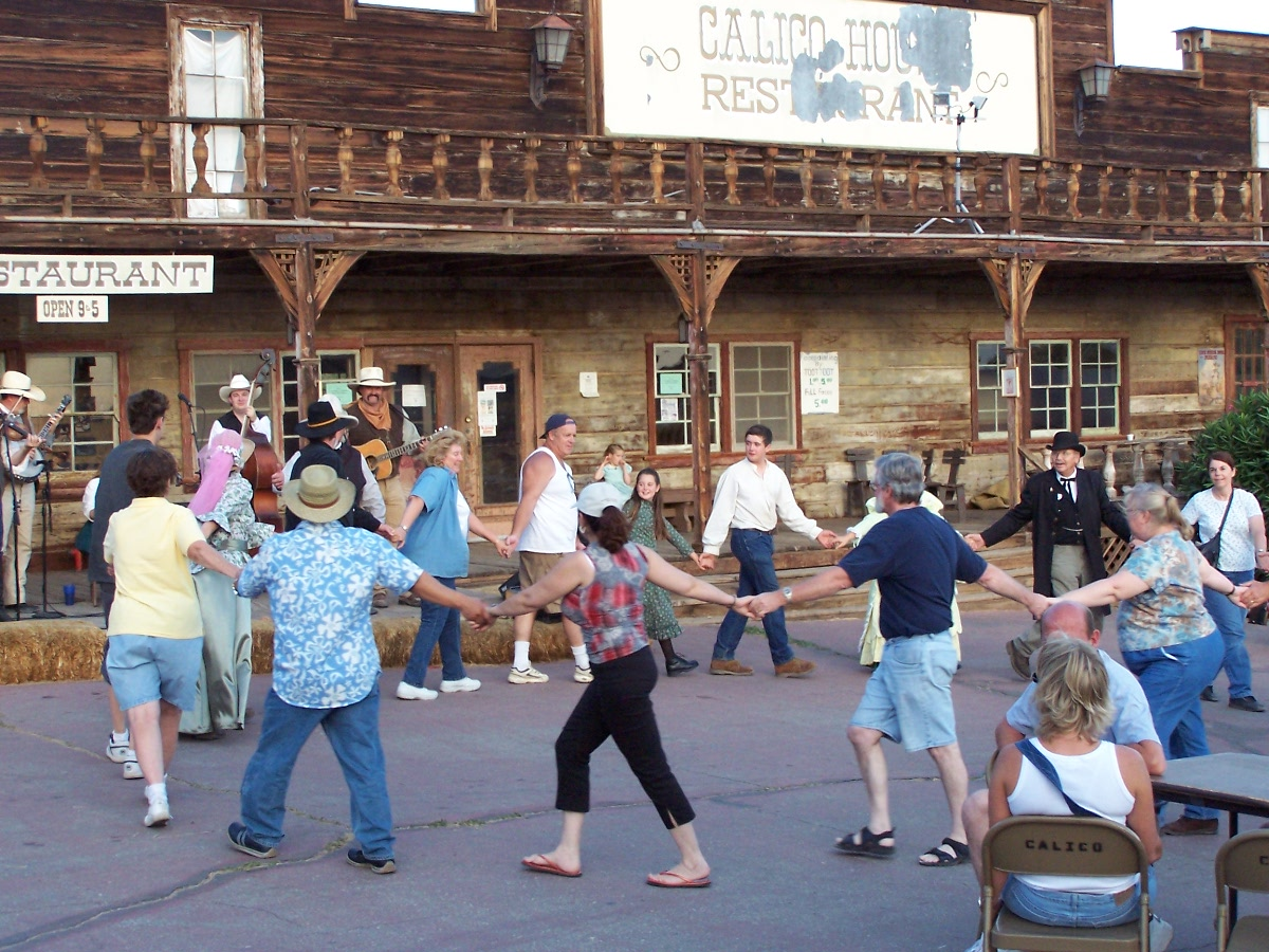 People Dancing in a circle at Calico