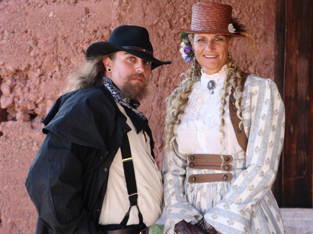 People dressed in western period clothing
