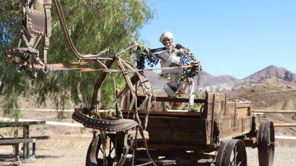 Skeleton driving a Haunted Wagon at Calico