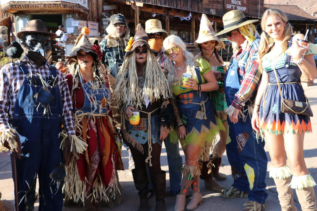 Adults in costumes for Halloween at Calico