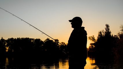 Person fishing at night