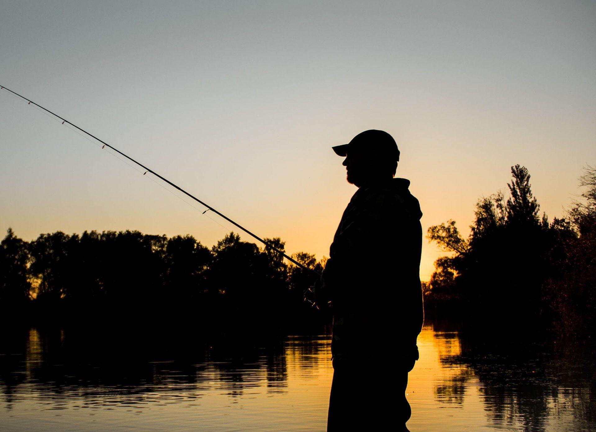 Person fishing at night