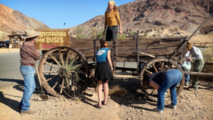 Volunteers at Calico standing near a wagon