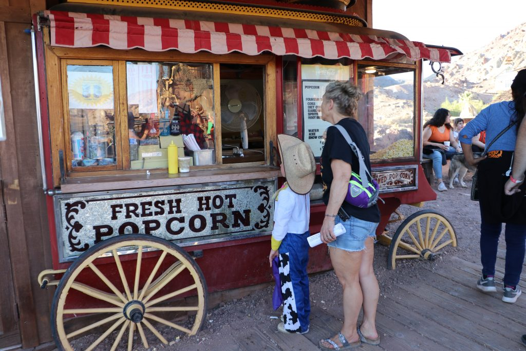 kid ordering popcorn